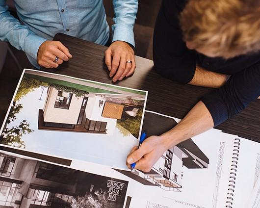 Dustin and Ian looking at digital renderings of homes