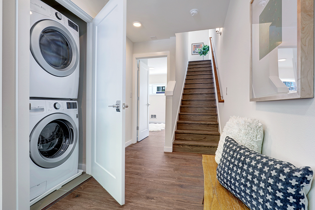 interior photo of laundry and stairs